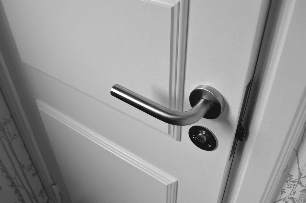 door needing locksmith repair