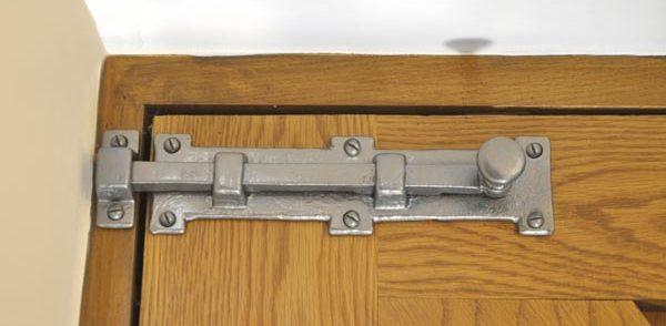 Door bolt installed on a wooden door