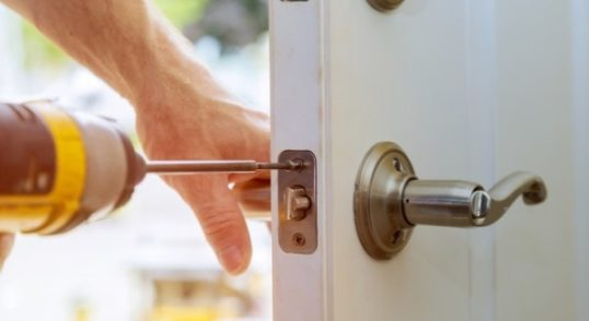 lock being installed on house door