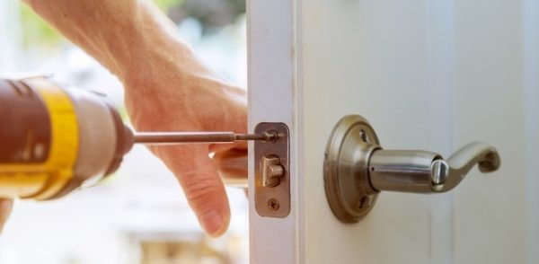 lock being installed on house door