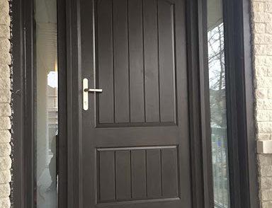 Brown steel door installed in a house