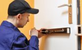 locksmith inspecting property security systems