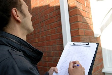 professional locksmith assessing a property's security