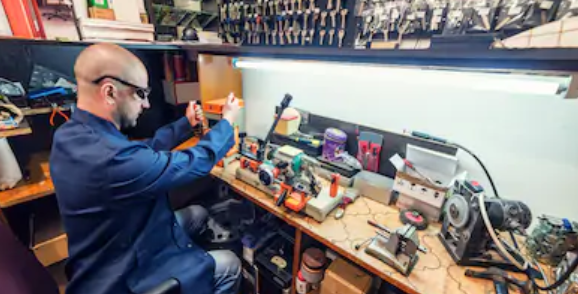 locksmith using security products in his workshop